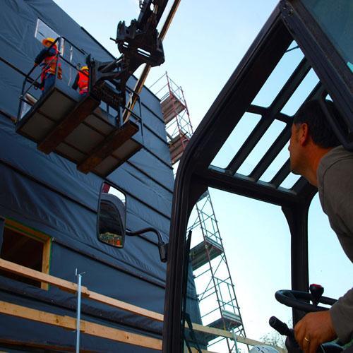 costruire in legno_edifici di soccorso_case antisismiche_ricostruzione aquila_ille haus