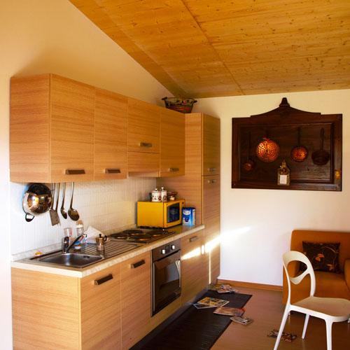 <b>BASIC_110</b> Render modello casa in legno monopiano a costi moderati.